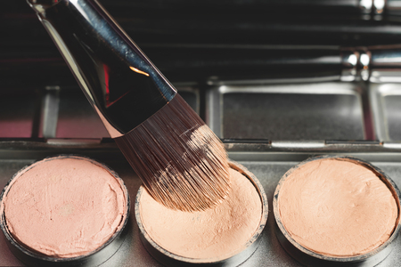 concealer: Professional cosmetic. Cream concealer. Working with skin defects. Stock Photo