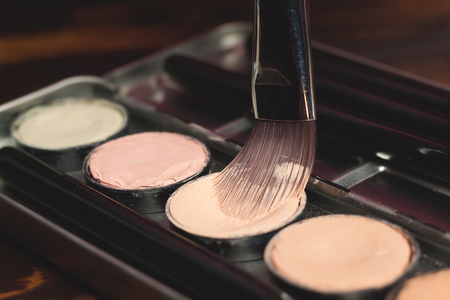 concealing: Professional cosmetic. Cream concealer. Working with skin defects. Stock Photo