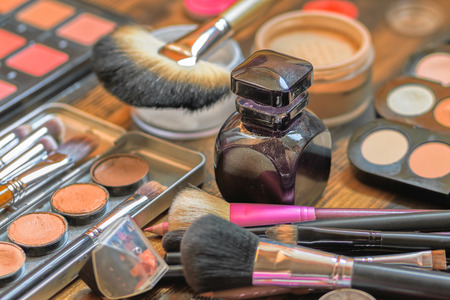 mess: Professional visagiste workspace. Makeup tools. Sreative mess