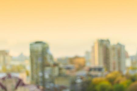 office buildings: Bokeh cityscape. Sunset background.