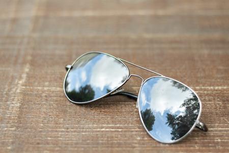 mirrored: Avionics sunglasses on wooden background Stock Photo