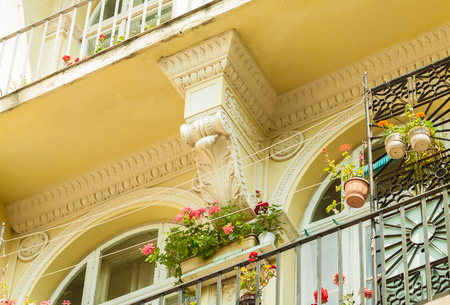 European balcony with flowers. Old architecture