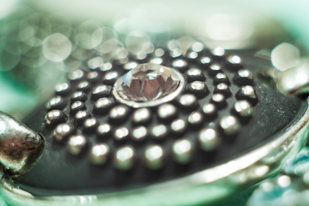 Blurry bijouterie wallpaper. Fragment of bracelet.