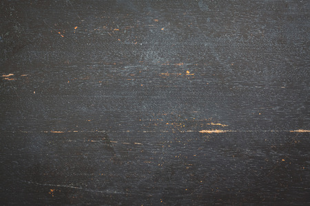 crannied: Black wooden background. Place for text.
