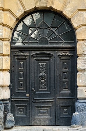 transom: The door of the old European building. Exterior design element of ancient Lvov. Example of world architectural heritage.