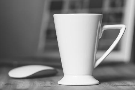 White mug on the wooden table Stock Photo
