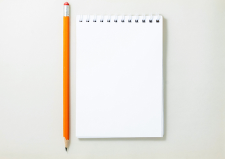 Top view of open spiral blank notebook on white background