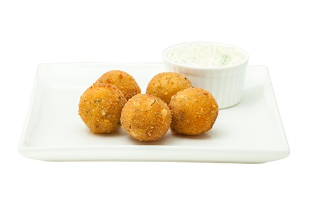 Cheese balls and mayonnaise sauce on a white square plate 版權商用圖片
