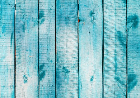 Turquoise blue wooden planks on direct sunlight. Flat view