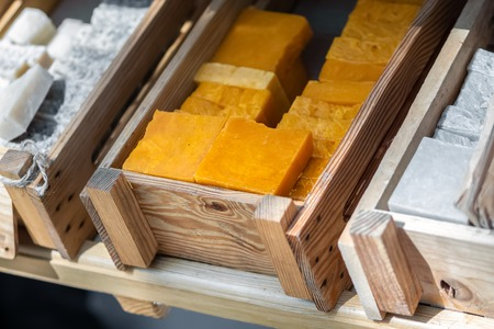 Handmade soap in wooden tray. A lot of slices Stock Photo