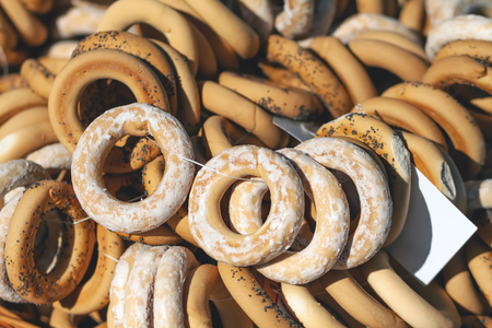 Bagels with glaze and poppy seeds. A lot of bagels Stock Photo