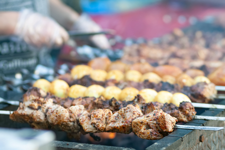 Tasty shish kebab cooking process. Grilled meat
