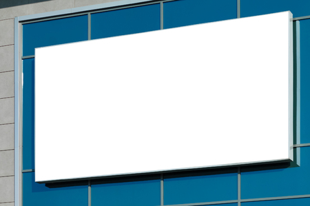 Blank horizontal billboard on glass facade. Background for mock-up. Stock Photo