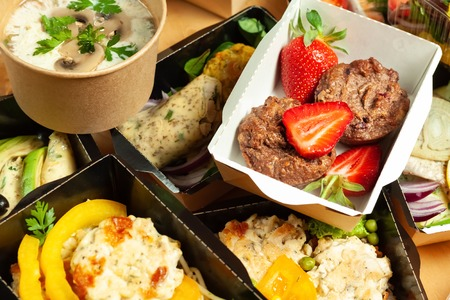 A lot of cardboard boxes with delicious and healthy food Stock Photo