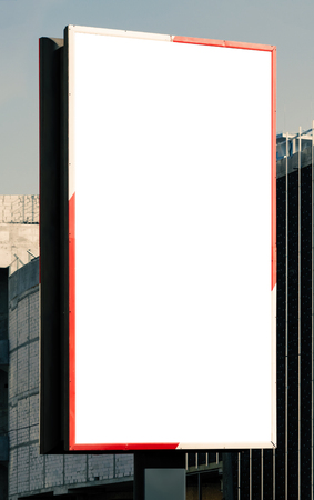 Blank vertical billboard on direct sunlight. Background for mock-up. Stock Photo