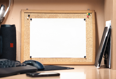 A cork board with a white sheet of paper. Background for mockup. Place for text.
