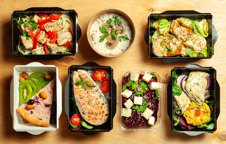 A full daily diet of healthy eating. Food in cardboard boxes. Flat Lay. Stock Photo