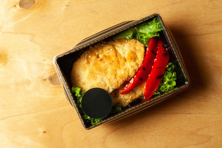 Chicken cutlet with grilled pepper and letucce salad Stock Photo