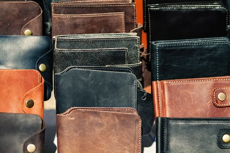 Leather wallets on the counter. Stock Photo