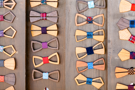 A lot of wooden bow ties. Market Showcase Stock Photo