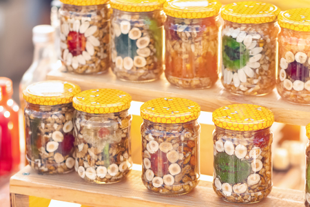Nuts and fruit in glass jars. Canned superfood