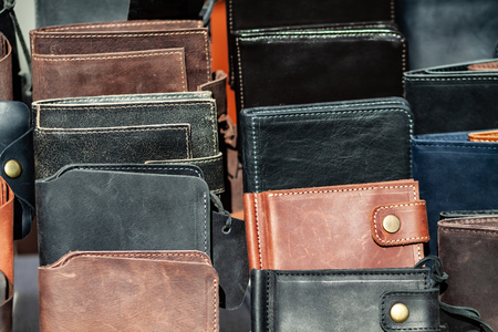 A lot of leather wallets on the counter.
