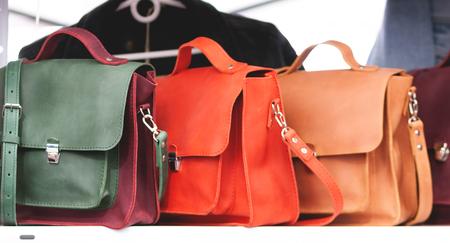 Three Womens Leather Handbags on direct sunlight Stock Photo