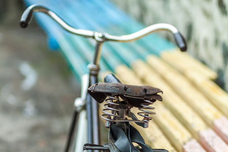 An old bicycle seat with a spring shock absorber. Stock Photo
