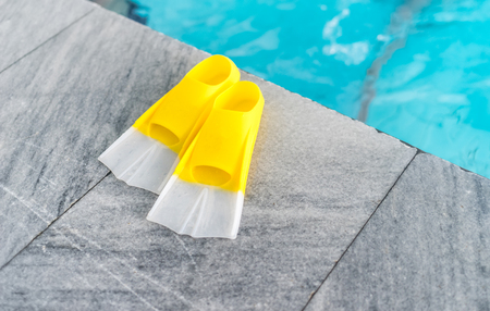 A pair of yellow flippers background. Stock Photo