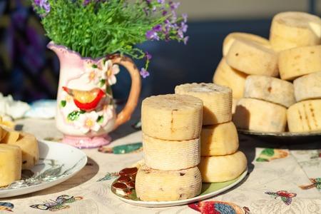 Farm organic cheese display on the table. Stock Photo
