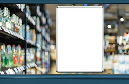 Empty advertising board in liquor store showcase