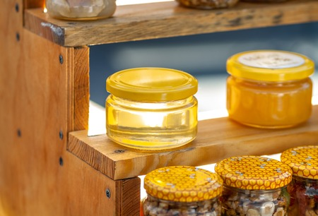 Natural honey in jars on the counter. Autumn Fair