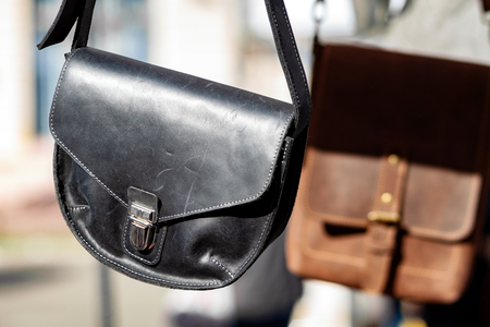 Black leather bag with a metal clasp