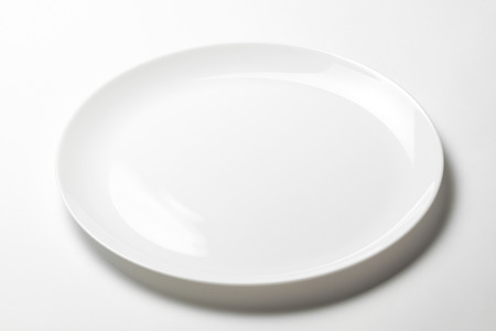 Whte plate without print on white background