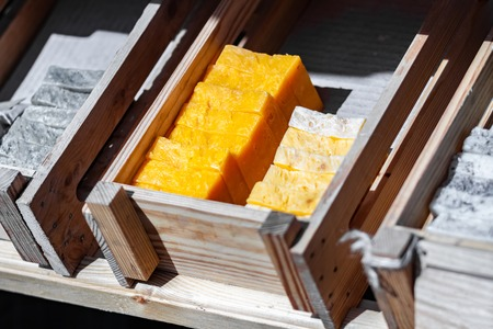 Handmade soap on a wooden tray. A lot of slices