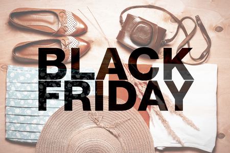 Black friday poster. Modern women outfit on background