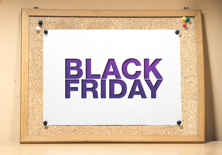 Black friday poster. A cork board with a white sheet of paper. Imagens