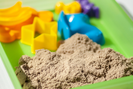 Kinetic sand close-up. Plastic molds for the game with kinetic sand.