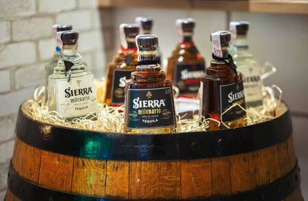 Kyiv, Ukraine, September 28, 2018. Sierra milenario tequila in a wooden barrel on Barometer international bar show. 新聞圖片