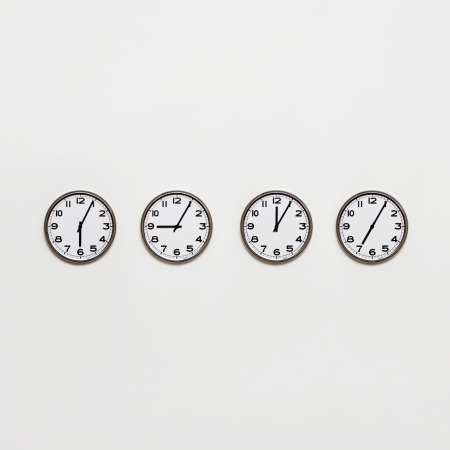 time zone: Different time zone clocks on wall Stock Photo