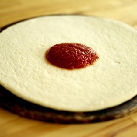 pizza base: Tomato sauce on a pizza base Stock Photo