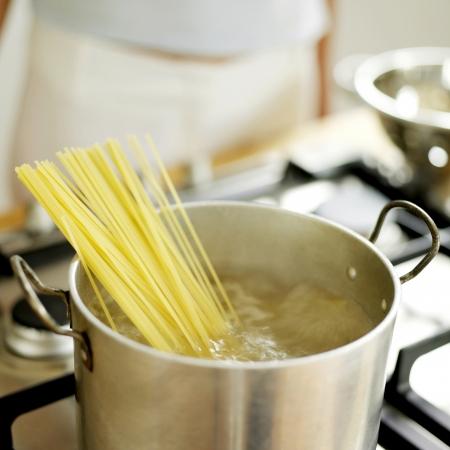 Spaghetti cooking in pan photo