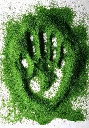 Handprint in colour sand Stock Photo