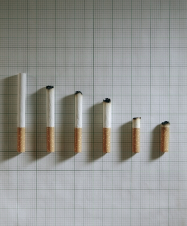 high angle shot: An arrangement of cigarette with different length Stock Photo