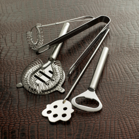 stirrer: Cocktail making tools (whisk, strainer, tray, bottle opener, ice tongs, and stirrer) Stock Photo