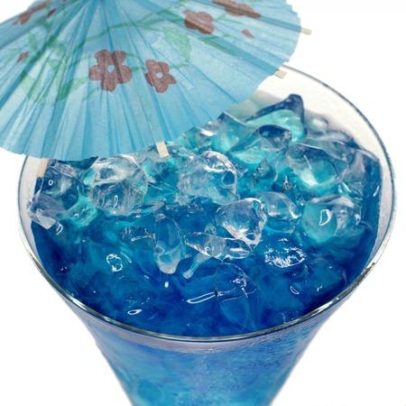 mini umbrella: Blue Curacao cocktail with ice and umbrella Stock Photo