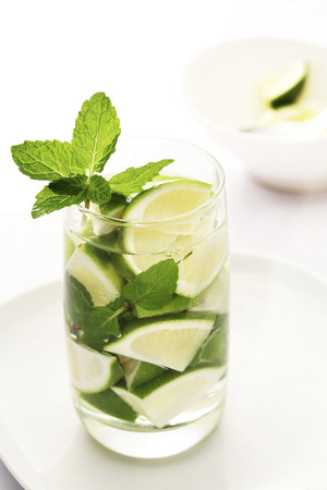 mint leaves: Lime wedges and mint leaves Stock Photo