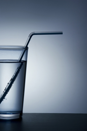 Drinking straw in a glass of water photo