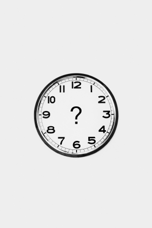 Clock with a question mark photo