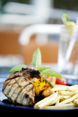Grilled meat and fries photo